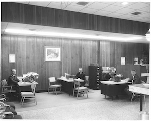 Ozark Bank bankers working at their desks in the late 1960s or 70s